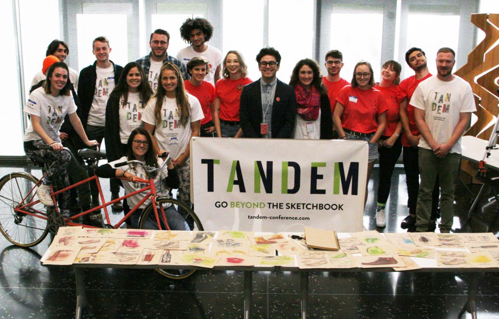 The student organizing team of the TANDEM Design Conference pause for a photo with Keynote Speaker Joey Zeladon.