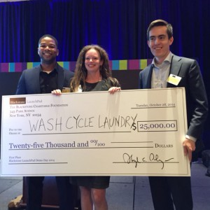(From left to right) Mike Banks, Wash Cycle Laundry comptroller, Zoe McKinley, PhilaU LaunchPad director, and Gabriel Mandujano, Wash Cycle Laundry founder and CEO, show Mandujano's first-place prize.