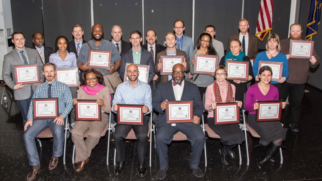 City employees receive Academy of Municipal Innovation certificates at a Dec. 2 ceremony in the  Lawrence N. Field DEC Center Forum.