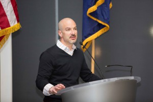 Andrew Buss, director of innovation management in Philadelphia's office of innovation and technology, addresses the graduating class at a certificate ceremony.