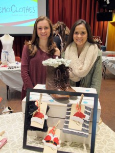 Fashion merchandising and management students Kimberly Hill, left, and Mary Lesher  sell boot cuffs at a campus pop-up shop.