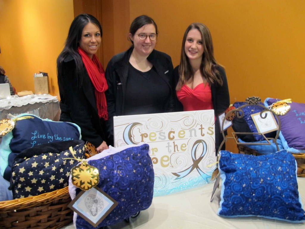 (From left to right) Jess Acchione, Ellen Miller and Brittany Veasey sell handcrafted pillow blankets at a campus pop-up shop.