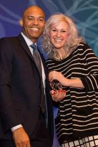 Tia Pion accepts her award from former Yankees pitcher Mariano Rivera.