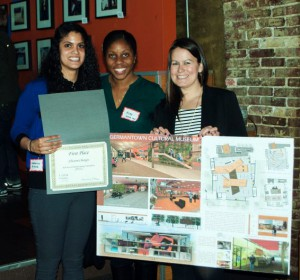 Chesenia Burgos (left) receives first place from IIDA leaders for her museum design.