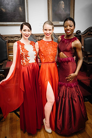 The three winning red dresses (left to right) were designed by students Maria D'Agostino, Sydney White and Lori Petrashune.