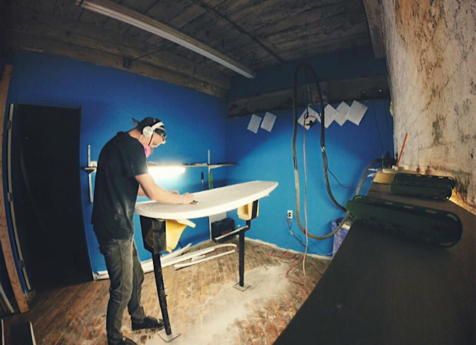 Colin Hansel constructs a surfboard. Photo credit: Colin Hansel.