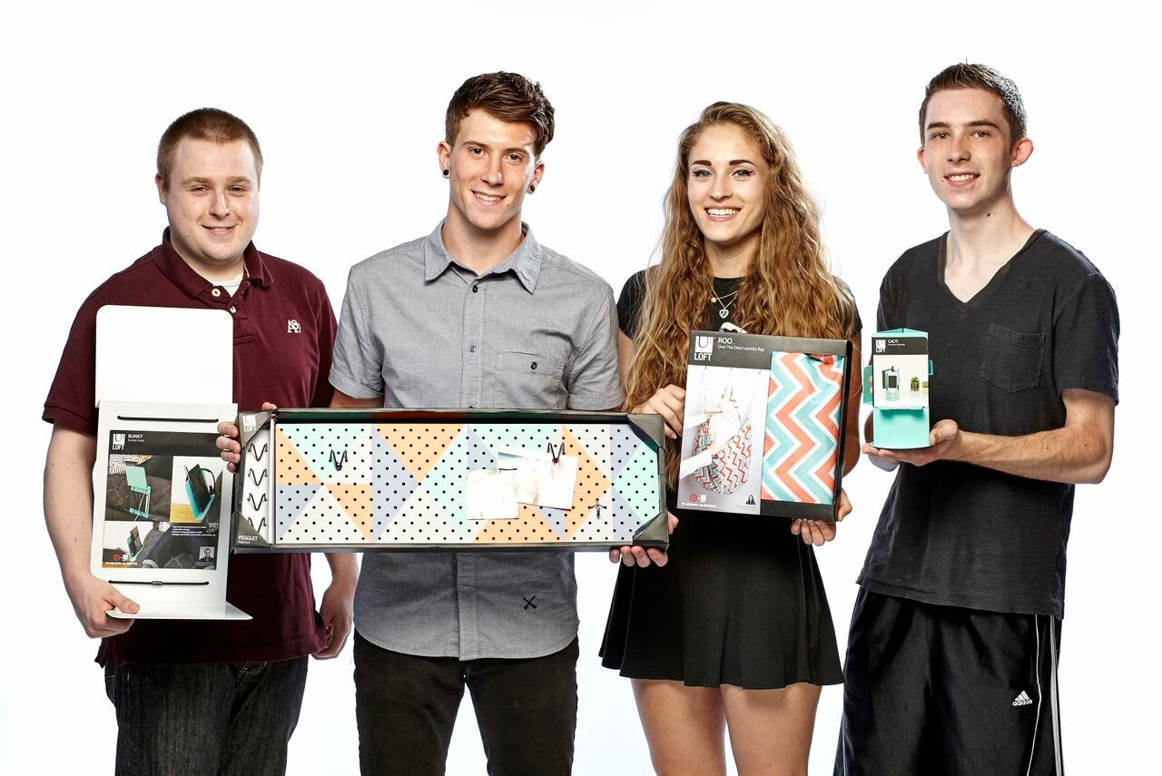 Industrial design students Nick Friez, Anthony Maladra, Chloe Muller and Sam Pawlak with their Target products. (Photo by Seth Andrew Shimkonis)