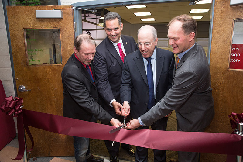 Kalevi Ekman, Rich Negrin, Stephen Spinelli Jr. and D.R. Widder (left to right) officially open the PhilaU Nexus Design Factory.