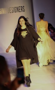Kayla Donovan is all smiles as she follows her collection down the runway.