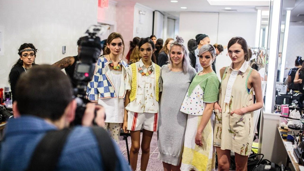 Fashion design graduate Tia Pion backstage with her collection at New York Fashion Week.