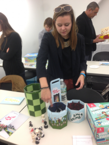 Graphic design communication senior Kelly Szymanowski presents her chess project.