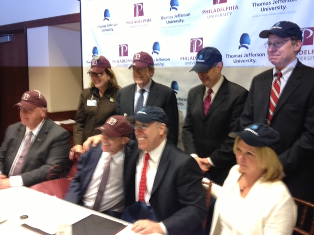 Thomas Jefferson University President Stephen Klasko and PhilaU President Stephen Spinelli Jr. (front row center) and leadership teams exchange hats.