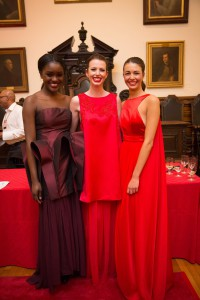 The three winning red dresses (left to right) were designed by students Arleny Corona, Ashlee Bowers and Amie Dews.