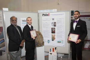 Mechanical engineering students Davin Pagan and Gussan Alkulaibi won a Nexus in Action award for their Dehumidifying Backpack that generates drinking water; engineering professor Muthu Govindaraj is on the left.