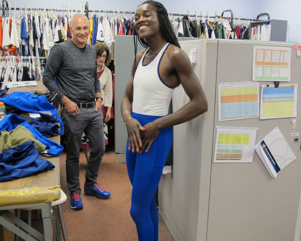 Textile engineer Mark Sunderland fits Olympic rower Chierika Ukogu for her seamless unisuit and tights.