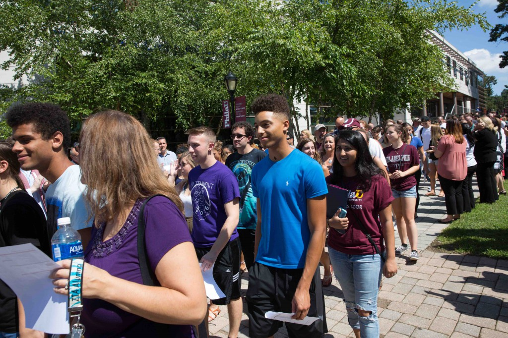 Faculty and staff cheered as new students and their families walked into Convocation.