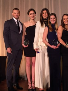 Vivian Cooper with Geoffrey Beene brand ambassador and actor Kellan Lutz and other YMA scholarship winners.