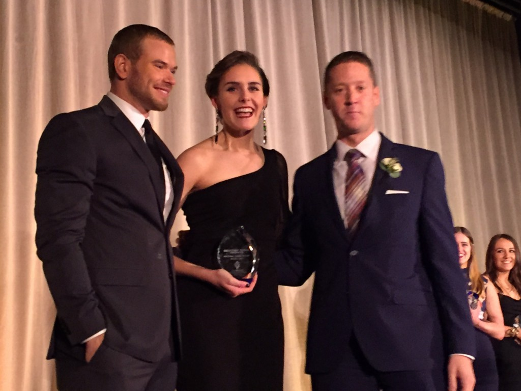 Vivian Cooper receives her award from actor and Geoffrey Beene brand ambassador Kellan Lutz and Marc Mastronardi, EVP of business development at Macy's.