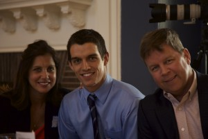 Delta Mu Delta member senior Mike Louden Jr. at last year's induction ceremony with his parents.