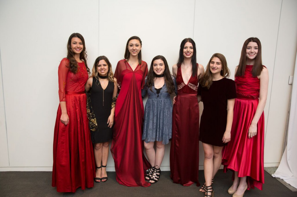 Fashion designers (from left) Alia Sod, Alana McHugh and Deanna Wedge stand to the right of their designs. Tricia Franklin (dress far right) is studying in Rome this semester.