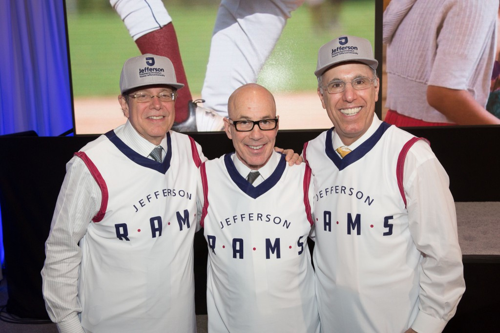 Mark Tykocinski, MD, Stephen K. Klasko, MD, MBA, and Stephen Spinelli Jr., PhD, debut the new Jefferson Rams uniform at the official combination ceremony.