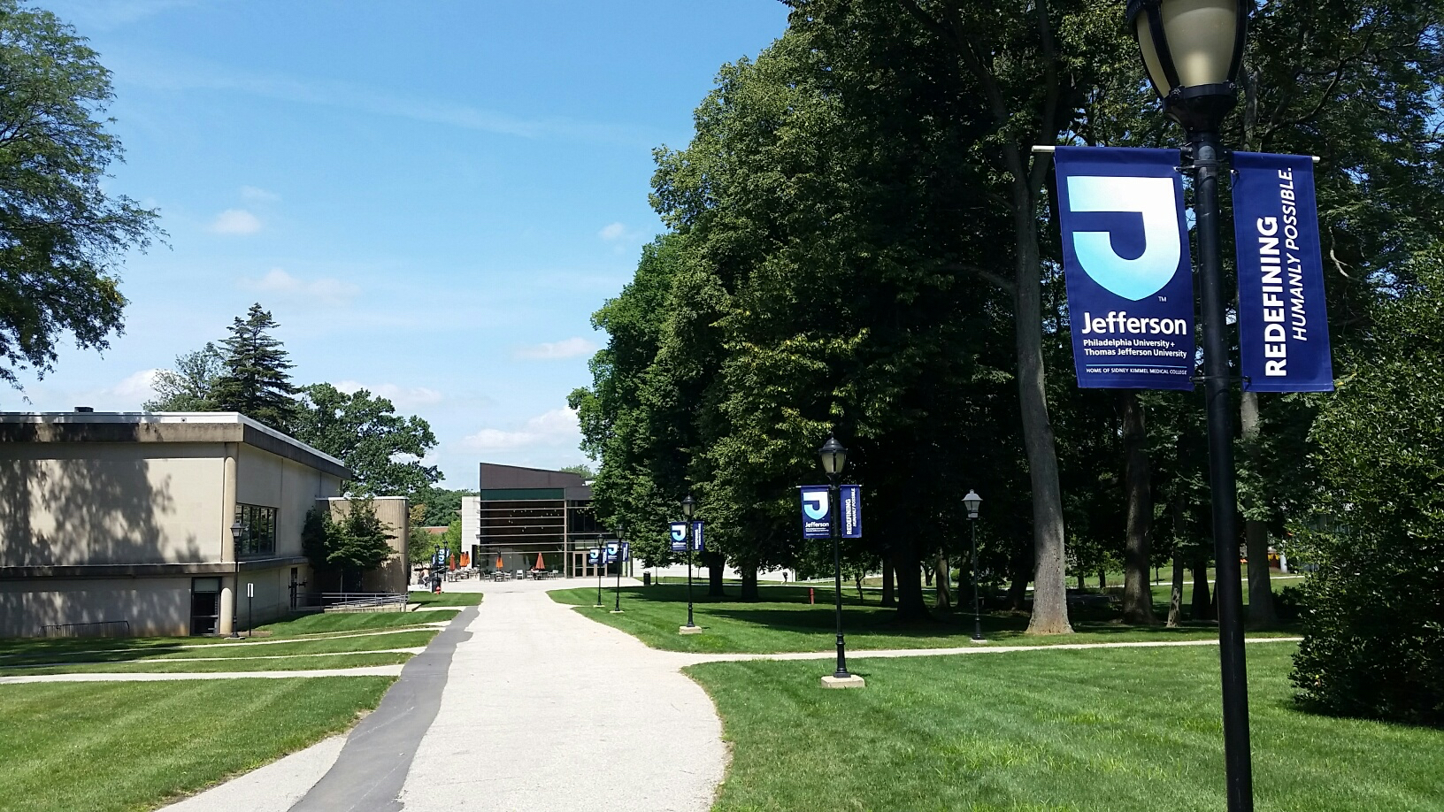 """Crews have added new banners on the walkways announcing Jefferson's motto """"Redefining Humanly Possible."""""""
