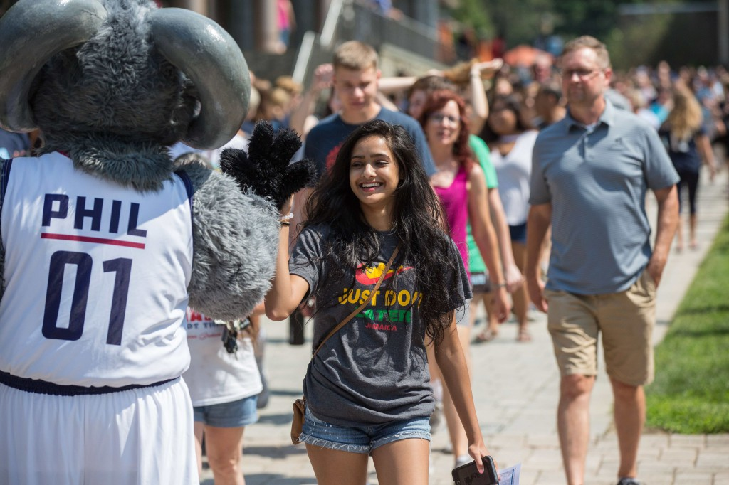 New students greet Phil the Ram as they walk into the Gallagher Athletic, Recreation and Convocation Center.