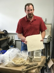 Professor Brian George turns hemp hurd from woody stalks to powder and then into usable sheets of materials in his laboratory.