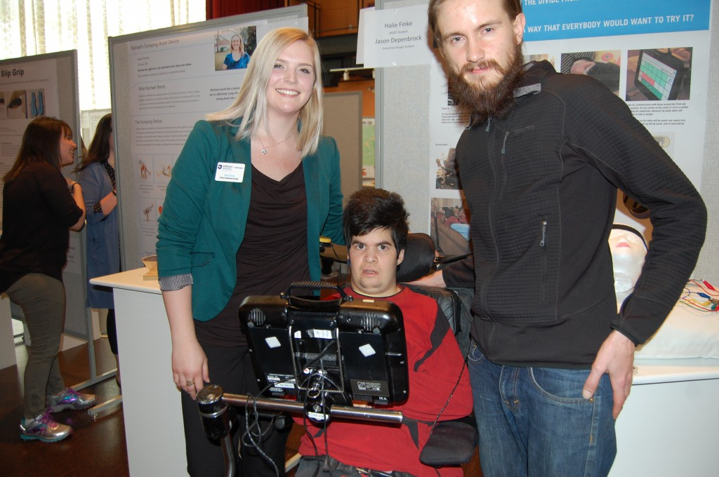 OT student Halie Finke and ID student Jason Depenbrock created a new assistive device that will allow their client to use his communication device while lying down or sitting in different positions.