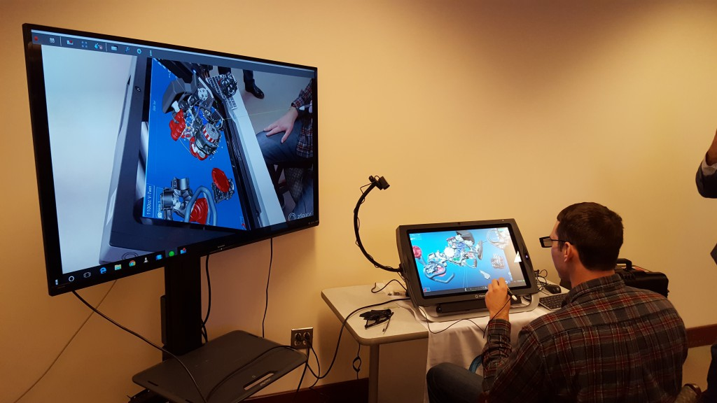Tyler Maher '17 works with the zSpace AR display.