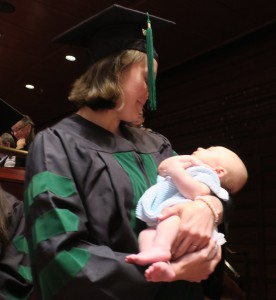 Some graduates brought their children on stage to receive their degrees.