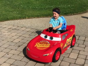 Four-year-old Logan enthusiastically cruised around East Falls Campus.