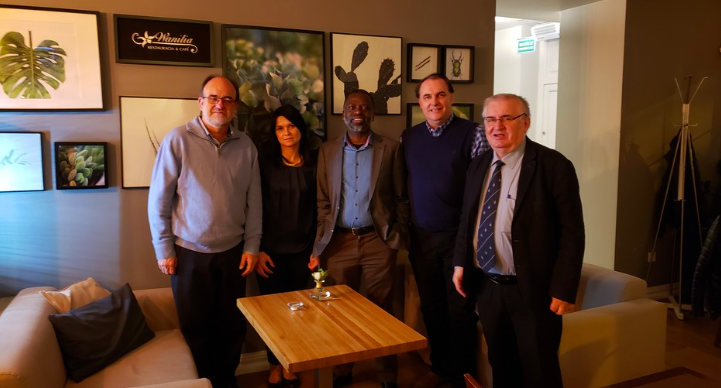 Jefferson's Les Sztandera (second from right) and Tshilidzi Marwala, of the University of Johannesburg (center), discussed potential collaboration opportunities.