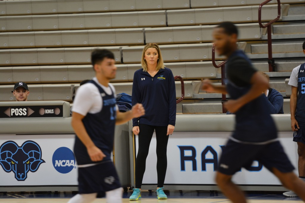Assistant coach Stephanie Carideo supervises practice as the Rams prepare for their home opener against Saint Anselm.